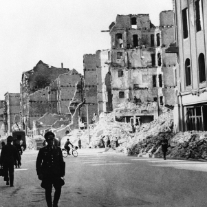 The fall of the German capital, show something of the tremendous devastation wrought in the city by Allied bombardments. Fires which raged for many days added to the plight of the inhabitants who, unable to obtain water, queued day and night. High explosives tore open many roadways and in some cases exposed the underground railway. Extensive damage suffered by buildings in Saarlandstrasse, one of the streets leading from the Potsdamer Platz in Berlin on Feb. 26, 1945. (AP Photo)