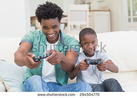 stock-photo-father-and-son-playing-video-games-together-at-home-in-the-living-room-294504770